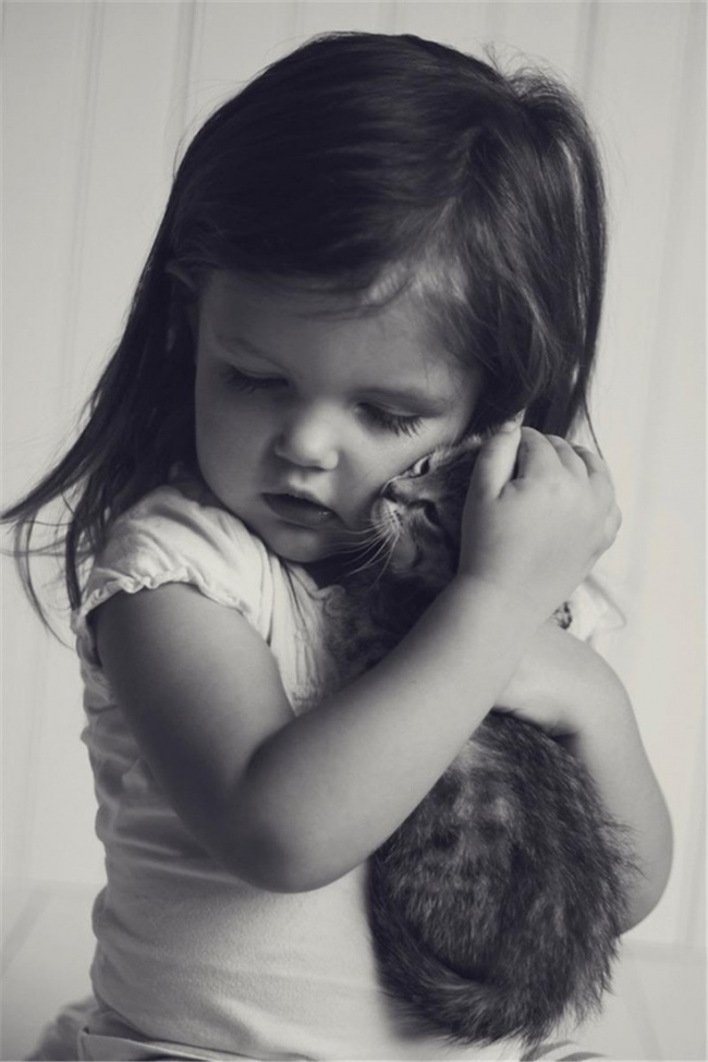 Kitten hugs girl