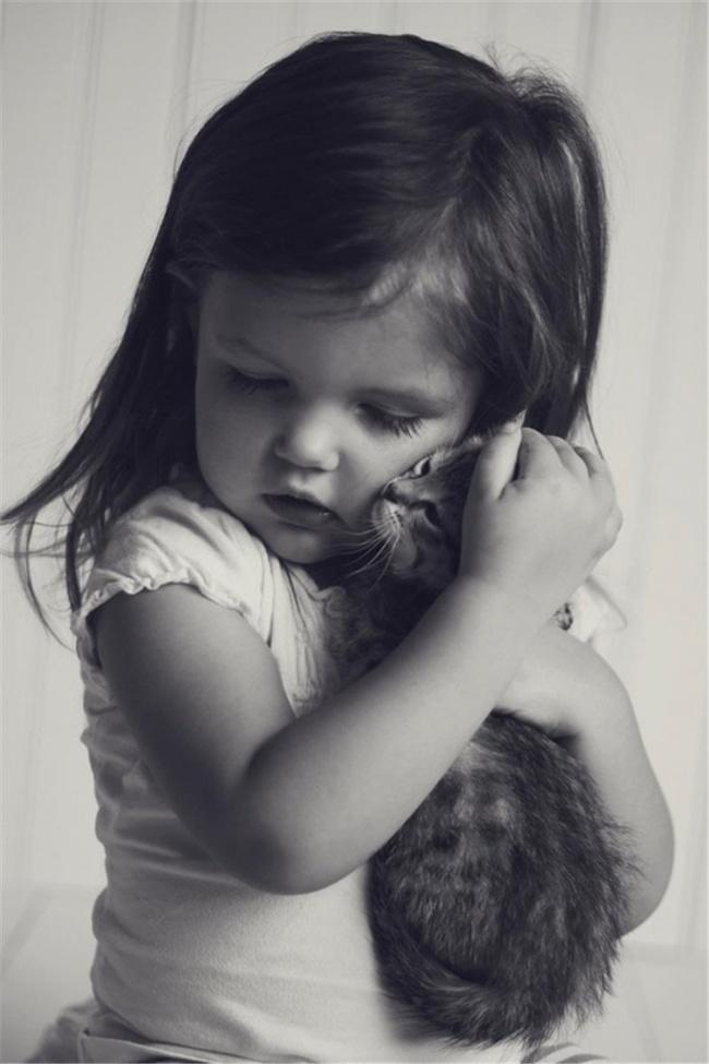 Kitten hugs girl