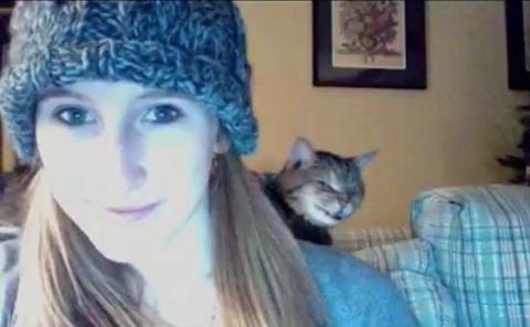 Creepy cat at the back