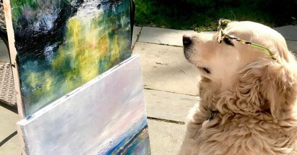 Ella Stares at a canvass painting